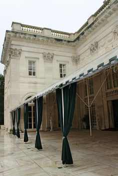 In Murder at Marble House, Alva V. entertains some early suffragettes here on the rear veranda. In later years, this will become an important gathering place for the women's suffrage movement.