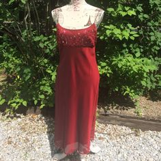 Gorgeous deep red Express dress! This stunning piece is a beautiful shade of red and has beading adorning the top and a fringe of beads around the hem. Express Dresses