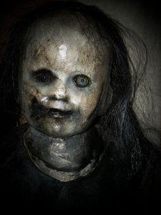 Creepy doll for haunted nursery