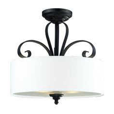 Add a touch of style to any room with this elegant flush mount light. The crisp white linen shade of this three-light fixture contrasts beautifully with the gracefully curved black fitting to create a delicate centerpoint for any room.