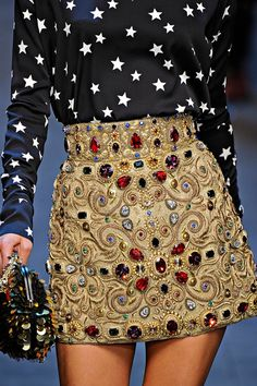 not even Dolce & Gabbana...love the skirt if worn on the right occasion, however, the top just doesn't match, and coupled with this skirt it looks ridiculous, discrediting the whole outfit. .