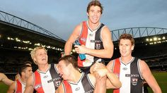 Lenny Hayes chaired off by Saints Nick Riewoldt, Steven Baker and Justin Koschitzke after his 200th game. Lenny Hayes: champion Saint.