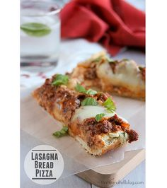 Lasagna Bread Pizza With French Bread, Olive Oil, Ground Beef, Onions, Garlic, Tomato Paste, Tomato Sauce, Dried Thyme, Dried Oregano, Salt, Pepper, Ricotta Cheese, Grated Parmesan Cheese, Egg Yolks, Parsley, Fresh Mozzarella, Fresh Basil