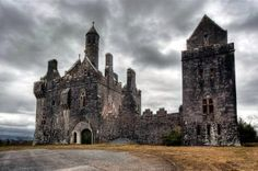 """This is Dromore Castle in Ireland. According to """"Ireland in Ruins,"""" Dromore Castle was designed in the Gothic revival style by Edward William Godwin and built for the Earl of Limerick in the early 1870's. It was abandoned by the family during World War 1 and finally sold in 1939. Its slow descent into decay began in the 1950's when the roof was removed to avoid rates being applied to the building and was later listed for demolition, although thankfully this has not come to pass."""