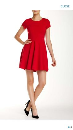 Perfect classily festive dress for the holidays, would work well with a nice black costume piece necklace