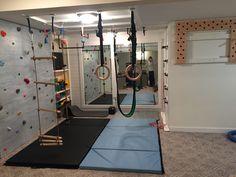 Indoor basement playground/ninja warrior gym/climbing wall/pegboard climber/indoor swing/gymnastic rings/chin-up bar