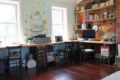 Bright built this his-and-her desk using salvaged butcher block from an abandoned North Philadelphia school. A clothesline between the windows displays the couple's collection of postcards, photographs and thank-you notes from clients.