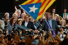 President of Catalonia Artur Mas (C) and President of Catalonia 'Esquerra Republicana de Catalunya' party (ERC) Oriol Junqueras (R) celebrate after the Catalanist coalition 'Junts Pel Si' (Together for the Yes) claimed victory in the regional elections held in Catalonia on September 27, 2015 in Barcelona, Catalonia.