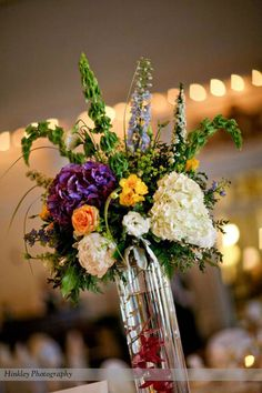 Tall centerpiece Tall ballroom style centerpiece with bells off Ireland, hydrangea, delphinium, lisianthus, roses, and freesia.