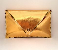 Handmade metallic leather clutch