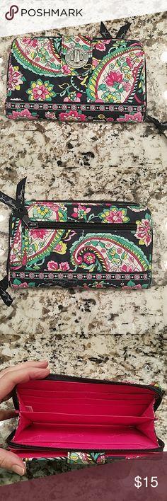Vera Bradley wallet Vera Bradley Wallet in excellent condition.  Very minimal fading on corners.  No rips or tears.  Smoke free home Vera Bradley Bags Wallets