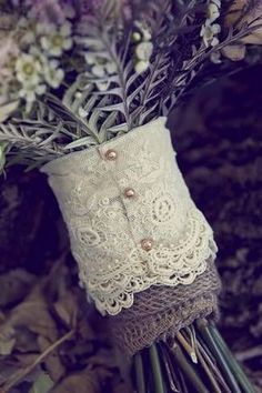 Instead of burlap black ribbon with white lace for a red rose bouquet
