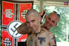 a Neo-Nazi giving his friend a hair cut