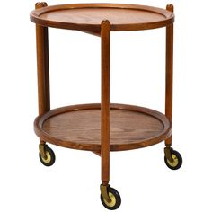 View this item and discover similar for sale at - This brilliant little Danish serving cart has a folding frame that supports two round removable trays. It's a wonderful occasional piece, perfect for serving Table Furniture, Antique Furniture, Modern Furniture, Serving Cart, Danish, Teak, Antiques, Tables, Home Decor