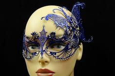 These Blue Metal Venetian Mask With Side Butterfly are the newest in our line of Venetian metal masks.  Each Blue Metal Venetian Mask With Side Butterfly is laser cut for exception detail and quality.  No masquerade ball is complete without some beautiful masquerade masks to go with it. Whether you are dressing up for your school prom or homecoming or just having a great Mardi Gras or carnival party to celebrate, you can't go wrong with our great selection of venetian masks, masquerade half…
