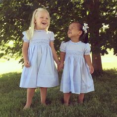 """In the cookies of life, sisters are the chocolate chips""  We are melting over these two in their Rose Garden dresses!  This beautiful dress is available in blue, pink, and white in sizes 3m-4t! http://www.feltmanbrothers.com/rose-garden-dress/"