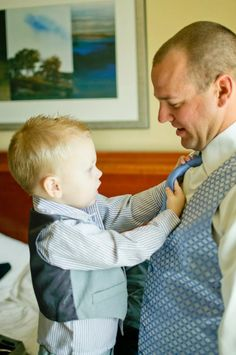 One of the ring bearers helped my groom get ready. This one melted my heart! :)