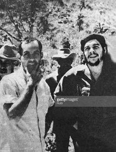 This 1960 file photo shows Cuban film director Tomas Gutierrez Alea (Titon) (L), discussing his film 'History of the Revolution' with Ernesto 'Che' Guevara (R) when Guevera visited the director on location. Titon, director of the film 'Strawberry and Chocolate,' died 16 April in Havana after a long battle with cancer.