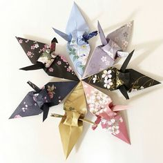 The origami cranes soldat Origami Land Deco are slightly different from the original design so that the cranes you purchase here are truly unique.  These are stunning and would make beautiful spring party decorations or beautiful decorative addition to a spring or summer wedding.  ORIGAMILANDDECO.ETSY.COM