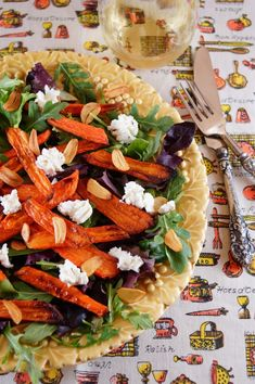 Roasted Carrot Salad with Arugula, Goat Cheese and Crispy Garlic Chips