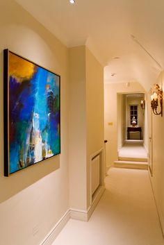 Polespring LED downlights used to emphasize artwork and sculpture at the end of the corridor -  http://www.johncullenlighting.co.uk/products/artwork-lights/polestar-led/?product_search=pole