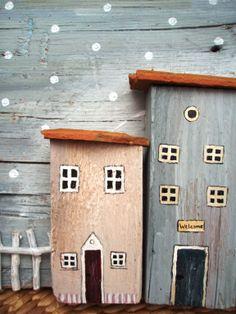 Wooden houses. Flat roofs for a change with real bits of roofing tile too, cool ;)