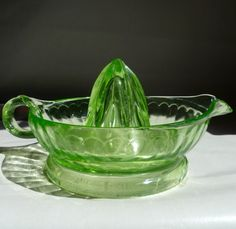 Green depression glass juicer.....my mother and grandmother had them and now I do too!