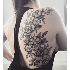 Beauty in bloom.   17 Tattoos That Prove Your Back Is The Perfect Canvas