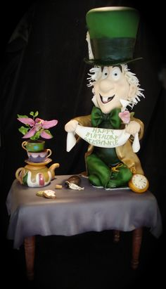 "3D Mad Hatter Cake 3D Mad Hatter Cake Done for an adult who is a HUGE Alice in Wonderland fan. Table is cake (two 9""x13"" side by side). Mad Hatter... #featured-cakes #mothers-day #tea-cup #teapot #tea #teacup #cakecentral"