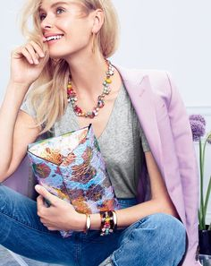 AUG '15 Style Guide: J.Crew women's Collection Ludlow blazer in light pink, vintage cotton V-neck tee, broken-in boyfriend Cone Denim® jean in Webster wash, horseshoe hoop earrings, crystal foliage necklace, thick hexagon cuff bracelet, crystal tortoise cuff bracelet and iridescent envelope clutch.