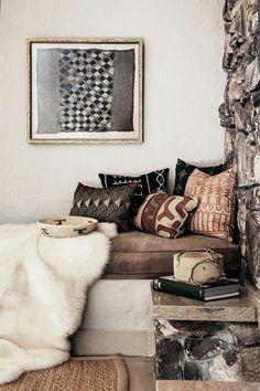 LOVE these textures mixed together: mixing the textiles (bed/floor/wall) and the stone wall: