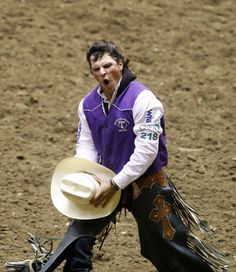 2014 CNFR, Saturday - Richmond Champion finishes his ride in the bareback. http://trib.com/sports/rodeo/gallery-cnfr-championships