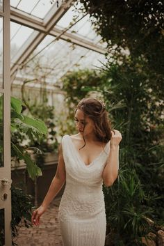 Elegant wedding gown with draping neckline | Image by Monika Pavlovic Photography