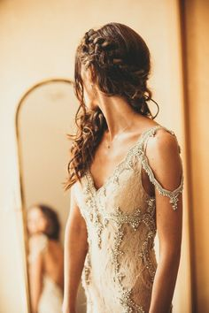 The crystal design on this vintage wedding dress looks like it came straight from an enchanted forest | Image by Davin Lindwal