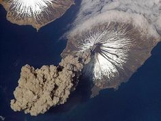 View of an Alaskan volcano erupting from Space.