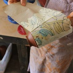 Transferring my hand drawn designs from paper to clay. Catie Miller Ceramic vase