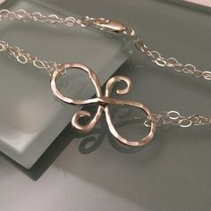 Friendship symbol bracelet Sterling silver friendship symbol bracelet. Hammered marked. Jewelry Bracelets