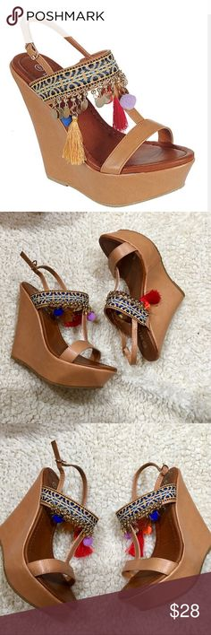 Tan boho wedges PRODUCT DESCRIPTION: Accent your look with this boho-inspired sandal decorated with a geometric strap, dangling details and a sky-high wedge.  5'' heel with 1'' platform Buckle closure Man-made Imported shoetemptations  Shoes Wedges