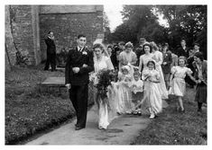 This 1947 photo shoes the Bridal Party leaving the Church. This wedding took place in South Wales UK