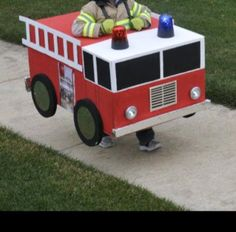 Homemade Halloween firetruck costume made out of a cardboard . - Cardboard Box , Homemade Halloween firetruck costume made out of a cardboard . Homemade Halloween firetruck costume made out of a cardboard . Boxing Halloween Costume, Homemade Halloween Costumes, Halloween Party, Cardboard Car, Cardboard Box Crafts, Cardboard Costume, Fire Truck Activities, Toddler Activities, Diy Karton
