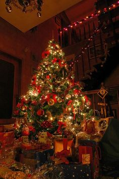 Standing in a room with christmas music softly playing in the background, the lights dimmed, and the tree lit. One of my favorite holiday moments. ?