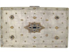 M. Buccellati Cigarette Case with Sapphires in Silver and 18K Yellow Gold - Brushed silver with yellow gold stars, four of which are set with square-cut sapphires, the centre motif similarly set with square and triangular sapphires. circa 1970.