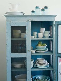 A French Flea-Market Retreat: See how these homeowners blend the romance of France with chic cottage flair in their San Francisco Victorian. Flea-Market Hutch: A set of white dishes are tucked into a blue china hutch that was found at a flea-market. Blue Cabinets, Cupboards, Kitchen Cabinets, Flea Market Finds, Cabinet Styles, China Cabinet, Crockery Cabinet, Cabinet Decor, Cabinet Ideas
