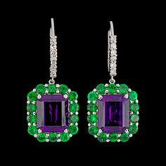 A pair of amethyst, 9.91 cts, tsavorite, tot. 3.55 cts, and brilliant cut diamond earrings, tot. 0.38 cts.  18k white gold. L. 3,5 cm.