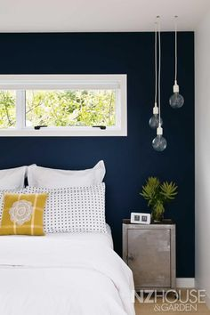 Caravan big bedroom , dark petrol blue colour, inside cupboards, also a little  bit of mustard yellow .