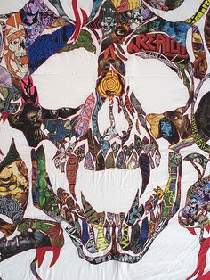 """Detail of """"See you on the other side"""" 13′ x15′ quilt made from over 125 Heavy Metal band T-shirts"""