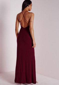 Slip into this slinky number this season for a seriously seductive look. With chic split to the front and crossover to reverse this burgundy maxi dress is a dream. Style with stunning silver strappy heels and metallic clutch for a luxe look...