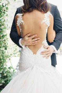 Sexy low-back lace wedding gown: http://www.stylemepretty.com/2015/09/28/romantic-malibu-vineyard-wedding/ | Photography: Jana Williams - http://jana-williams.com/