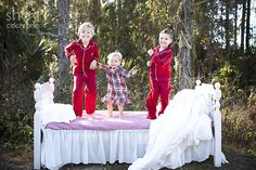 2012 Shay Cochrane Photography | www.shaycochrane.com    christmas portrait, kids, laughing, jumping, kids photography, siblings, outdoor, white bed, red pajamas, family
