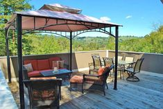 Wood deck with steel gazebo with canopy shade and outdoor furniture